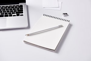 close-up shot of notebook and pencil