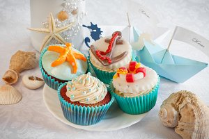 Cupcakes, wine bottle and paper boat