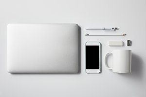 top view of laptop with smartphone a