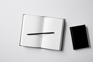 top view of black notebooks with pen