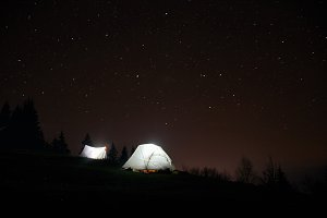 Camping under the stars at night in
