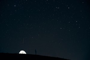 Illuminated lonely tent in the