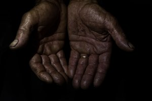 Two hands of an old man marked and s