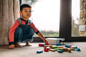 Innocent little kid with toys