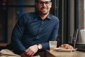 Smiling man sitting in restaurant