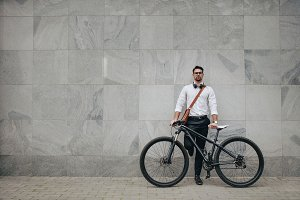 Man standing with a bicycle