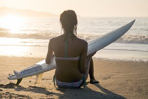 Surf girl at sunset