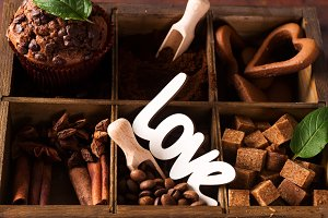 Spices, coffee and cookies in wooden
