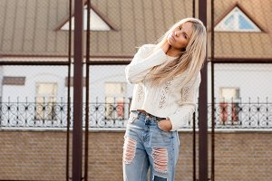 Girl dressed in ripped jeans