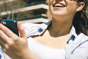 Woman smiling using her phone