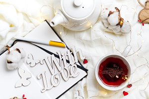 Hot healthy tea with teapot on