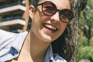 Woman with sunglasses laughing