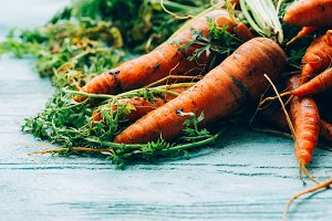 lot of carrots on a wooden backgroun
