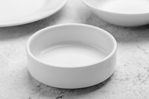 Clean white plates on stone table
