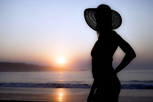 Woman at sunset on the beach