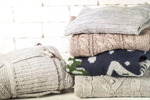 Stack of cozy woolen clothes on