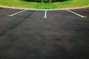 Curved empty car parking stop backgr