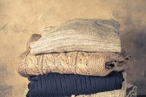 Stack of cozy woolen clothes.