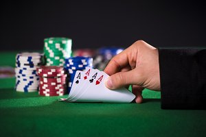 Closeup of poker hand with four aces