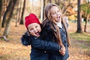 Two happy children hugging