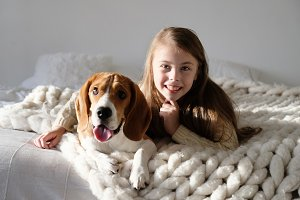 Cute child resting with beagle dog