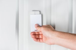 person opening door with electronic