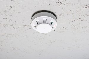 smoke detector of fire alarm on whit