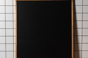 empty chalkboard in wooden frame sta