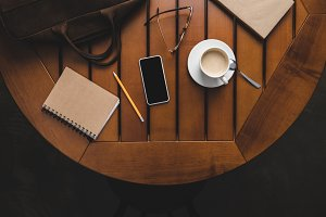 smartphone, notepad and cup of coffe