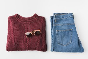 trendy knitted sweater and jeans and