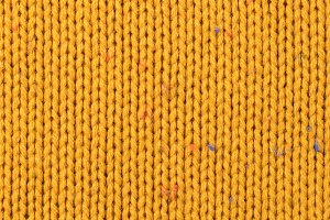texture of knitted yellow sweater