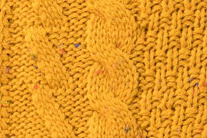 texture of yellow sweater with patte