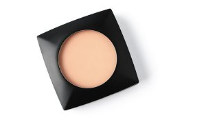 top view of cosmetic powder in black