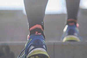Athlete runner feet running in natur