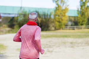 Senior runner while training for a c