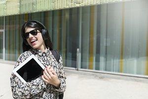 Beautiful woman holding a digital ta