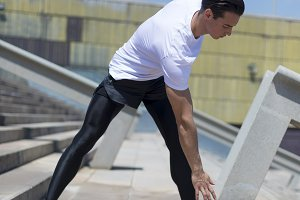 Muscular athlete working outdoors st