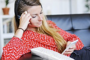 Happy woman listening to music weari