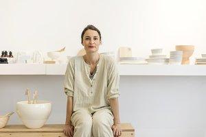 Woman in work wear in her workshop b