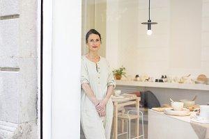 Woman standing in work wear in her w