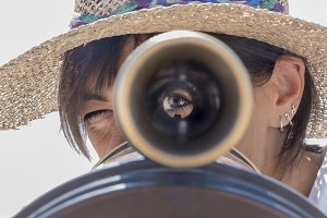 Woman using a binoculars in the city