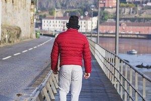 unrecognizable Sporty man walking al