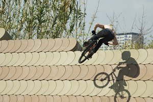 Unrecognizable BMX rider performing