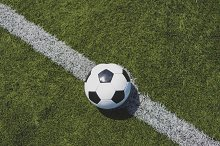 Soccer ball on green grass over the  by  in Sports