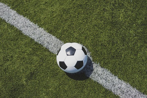 Sports Stock Photos: 2Design stock imagery  - Soccer ball on green grass over the