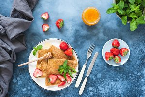 Crepes or blini with strawberries