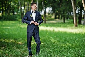 Portrait of a handsome groom posing