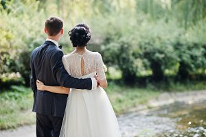 Fantastic wedding couple hugging and