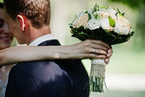 Close-up photo of wedding couple hug