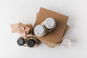 top view of pizza boxes and coffee t